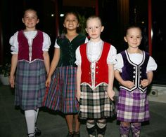 Second from right: Kilt with red vest #macpherson #Black #tartan