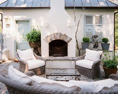 outdoor fireplace against house, woven chairs, neutral cushions, flagstone patio Outdoor Rooms, Outdoor Dining, Outdoor Ideas, Porches, Enchanted Home, Outside Living, Living Room Inspiration, Plein Air, Home Design