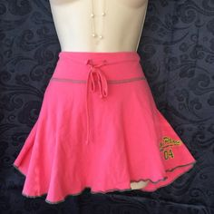 Forever 21 Miniskirt Size Medium This is a very cute miniskirt  by forever 21 in the color of pink and is size medium,with a drawstring waist.Measurements are waist 16 and from waistband to bottom of skirt is 13 1/2. Sorry no trades. Forever 21 Skirts Mini