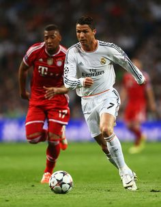 Cristiano Ronaldo takes on Jerome Boateng during the UEFA Champions League semi-final first leg match between Real Madrid CF and FC Bayern München at Estadio Santiago Bernabéu on April 23, 2014 in Madrid, Spain.