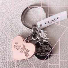 Pretty in pink Trades Beautiful rose gold colored key fob. Authentic. Super sweet Coach Accessories