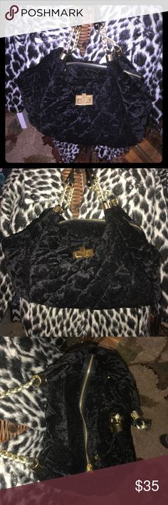 Black velvet purse Black velvet quilted look, gold hardware & patent leather handles, roomy inside, zipper pocket inside with 2 pockets for storage as well. Never used. Bags Shoulder Bags