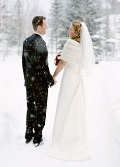 Winter Wedding Photography  ....  the down side is that the white bride blends into the white background and disappears