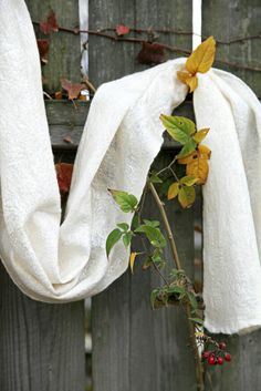 Merino Nuno scarf embellished with silk threads.