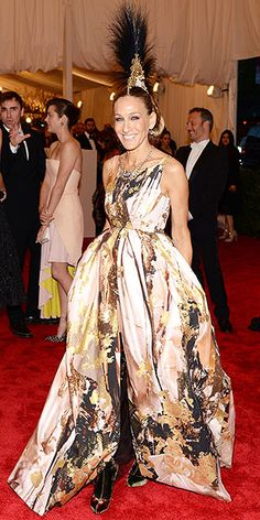 SARAH JESSICA PARKER - Met Gala 5-6-2013 Ding, ding! SJPs Philip Treacy headpiece is the moment youve been waiting for. She pairs it with a voluminous Giles Deacon gown and plaid Christian Louboutin boots.