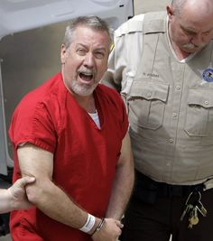 In this May 8, 2009 file photo, former Bolingbrook, Ill., police sergeant Drew Peterson yells to reporters as he arrives at the Will County Courthouse in Joliet, Ill., for his arraignment on charges of murdering his third wife.  In fact, it is widely believed he murdered three of his four wives in order to obtain money and property. Really a scumbag.
