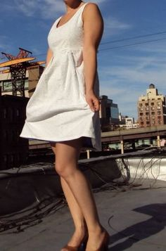 Eyelet and sleeveless with a full skirt.