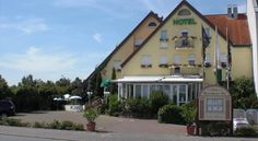 Hotel Bauschheimer Hof Rüsselsheim This hotel on the green outskirts of Rüsselsheim enjoys a peaceful location, free Wi-Fi and quick motorway access to the Rhine-Main region's economic centres of Frankfurt, Mainz and Darmstadt.