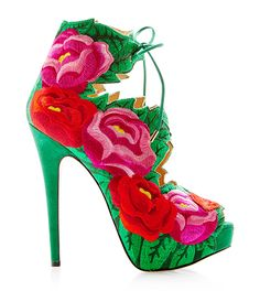 Whether big and bold or mini and abstract, it's safe to say that florals have and will always bloom in the spring—at least in fashion and now in shoes. This season, our beloved botanical trend has blossomed into fresher-than-ever bouquets—including some of our most coveted must-have accessories of the season, like the Charlotte Olympia Hibiscus Belinda platform flower sandal. From Oscar de la Renta to Chanel, Givenchy to Etro, Dolce & Gabbana to Gucci, this sartorial garden is in full bloom!