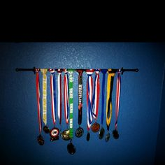 My son's wrestling medals hung on a curtain rod.