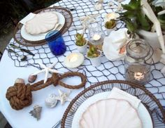 Nautical table decor with fish net and rope knot.