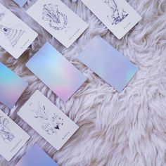 The Luminous Spirit Tarot Deck - Holographic back with minimalist drawings.  Holographic Tarot Deck, Oracle Deck, Tarot Cards, Independently Published Tarot Deck, Witchcraft, Wicca, Mysticism, Illustration, Rainbow, Iridescent, Design