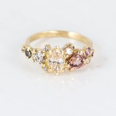 14k Yellow Gold Cluster Statement Ring with Champagne and Cognac Diamonds, Pink Zircon and Purple Sapphires. Handmade jewelry by Artisan Melanie Casey.