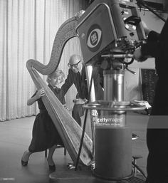 Harpist Pearl Chertok at the harp on The Ed Sullivan Show, with the show's conductor, Ray Bloch. Image dated April 8, 1962.