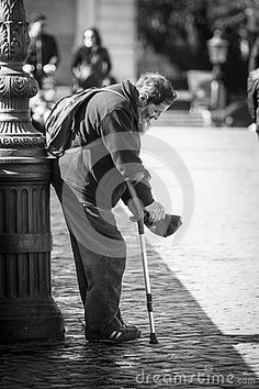 Beggar in the street. Poverty and Charity