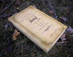 """Grab a book, print out this book cover by Heather at Chickabug """"Spell Book Printable"""" and you have a simple, fun addition to your Halloween decor!"""