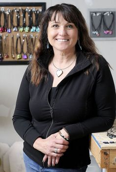 Rebecca Watson makes jewelry from glass. She owns Providence Hill Glass. (Photo by Eli Lucero)
