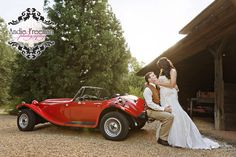 Bride and groom portrait with vintage red car. Country fall wedding at hunting lodge.  Photography:  Andie Freeman Photography www.TheAthensWeddingPhotographer.com Coordinating, floral, and event design:  Wild Flower Event Services Venue:  Fair Weather Farms, Monroe, GA Catering:  Master's Table www.cateringbythemasterstable.com
