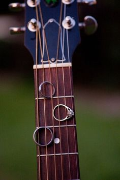 Wedding ring shot on guitar neck