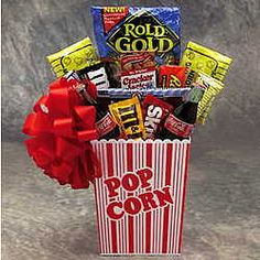 America's Favorite Snacks Gift Basket. 2 Nostalgic Classic Cokes  Reese's® Peanut Butter Cups  M's  Oreos  Wrigleys  2 Microwave popcorn  Nestle® crunch chocolate bar  2 small Rold Gold pretzels  Red Vines  Rice Krispies Treat  Chips A Hoy Chocolate chip Cookies  popcorn container