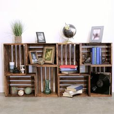 DIY Wooden Crate Shelf (This would only work with genuine vintage crates as ones… - Wooden Crates Bookshelf Old Wooden Crates, Diy Wooden Crate, Vintage Crates, Diy With Crates, Wooden Vase, Wood Crate Shelves, Crate Bookshelf, Crates On Wall, Rustic Bookshelf