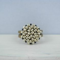 Peyote beadwoven ring in silver and black by IzabelDesigns