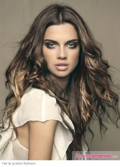 She looks a little too fierce for me but I love her hair! I would do darker though. ..