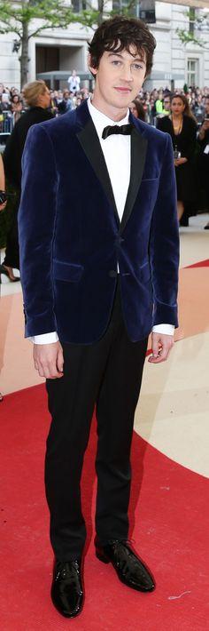 British actor Alex Sharp in a blue velvet Burberry tuxedo jacket with satin lapels at the MetGala