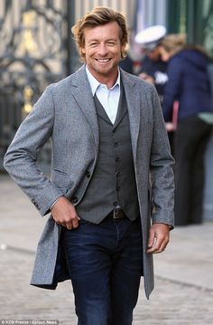 Great hair - From Paris with love! Simon Baker dresses in stylish vest and coat jacket during a photoshoot in France
