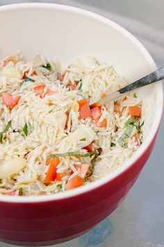 Summer Lemon Orzo......Orzo with artichoke hearts. tomatoes, basil, lemon, olive oil and parmesan cheese:  This salad is light and refreshing. I added some olive for an added saltiness.   Side note: It make a big bowl! My hubby and I will be eating this for a few days!! I'm thinking of adding avocados for a meal and BBQ for another. Mmm.....