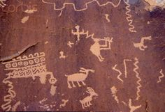 """""""Zuni Petroglyphs that date from AD 1000-1100, representing hunting, planting of corn, rivers and Kokopeli, at the Village of the Great Kivas Anasazi ruins on the Zuni Indian Reservation, New Mexico."""" - photo by Marilyn Angel Wynn, via Corbis Images; at the Zuni Reservation, New Mexico"""