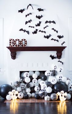Halloween is a fun time to play dress-up and entertain friends and trick-or-treaters. Getting your home into the Halloween spirit doesn't have to be hard, and you don't have to go over the top. A few little touches of Halloween… Continue Reading → Spooky Halloween, Modern Halloween Decor, Halloween Fireplace, Halloween Balloons, Halloween Birthday, Outdoor Halloween, Diy Halloween Decorations, Holidays Halloween, Halloween 2019