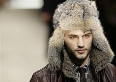 Pitti Uomo, the most important men's fashion show, has opened in Milan with offerings like his trapper's hat from Dolce & Gabbana