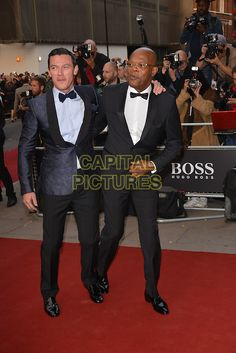 LONDON, ENGLAND SEPTEMBER 02:  Luke Evans, Samuel L Jackson attend the GQ Men of the Year 2014 awards in association with Hugo Boss at The Royal Opera House on September 2, 2014 in London, England.<br /> CAP/PL<br /> ©Phil Loftus/Capital Pictures