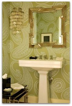 green and gold bathroom with paisley wallpaper