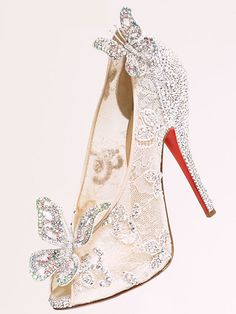 Shoe designer Louboutin was invited by Disney last April to bring Cinderella's iconic slippers to life, and they were finally revealed during Haute Couture Paris fashion week. These delicate lace Cinderella wedding shoes are feminine and sparkly, with a touch of whimsy and familiar Disney magic.