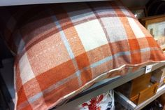 Plaid cushion. Cool. Next.