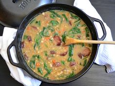A hearty navy bean soup with sausage & spinach that is full of flavorful herbs and will warm you inside and out on cold winter night. @budgetbytes