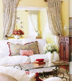 I would have liked the draperies tied in better- is there some yellow in the fabric?, but it is comfortable looking & the draperies used at the archway give a soft unexpected accent.