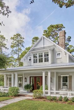 We're Loving This Lowcountry Farmhouse House Plan is part of House plans farmhouse - Classic Southern architecture, breezy colors, and a dose of cozy textures create a new home with a comfortably old feeling Southern Farmhouse, Southern House Plans, Modern Farmhouse Exterior, Farmhouse Front, Farmhouse Plans, Farmhouse Design, Rustic Farmhouse, Southern Charm, Farmhouse Homes