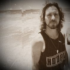 Eddie Vedder- I don't even care that he's wearing a wife-beater!
