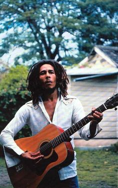 "Bob Marley, with his guitar in the yard at home (Tuff Gong) in Kingston, Jamaica. March 1976 / Robert Nesta ""Bob"" Marley, OM February 1945 – 11 May Damian Marley, Reggae Rasta, Reggae Music, Peter Tosh, Music Love, Music Is Life, Pop Music, Ziggy Marley, Robert Nesta"
