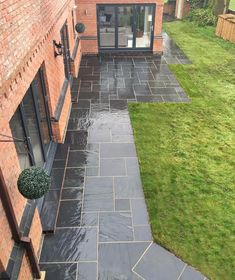 Our Blue Black Slate Patio Kit also looks great when wet! Slate Garden, Slate Patio, Garden Paving, Garden Stones, Lush Garden, Slate Paving Slabs, Patio Slabs, Patio Stone, Paver Walkway