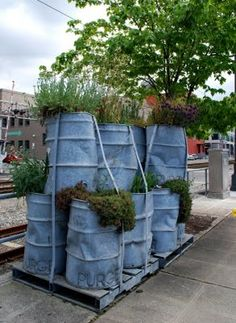 Cool, but probably not thematically appropriate for my garden.  Maybe stock tanks instead?  Oooh, stock tank herb garden!