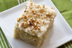Banana Cake with Cream Cheese Frosting _ ◦2 cups all-purpose flour   ◦2 teaspoons baking powder   ◦1/2 teaspoon salt   ◦4 tablespoons unsalted butter, at room temperature   ◦2 tablespoons canola oil   ◦3/4 cup granulated sugar   ◦2 large eggs, at room temperature   ◦1 large egg white, at room temperature   ◦1 teaspoon vanilla extract   ◦4 large ripe bananas   ◦1/4 cup milk