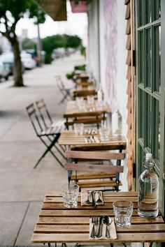 small tables and chairs in front of coffe shop