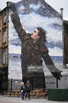A mural of comedian Billy Connolly displayed on a gable wall in the Dixon Street on June 12, 2017 in Glasgow, Scotland. Three murals based on original portraits by Scottish artists John Byrne, Jack Vettriano and Rachel Maclean have been created to mark the Glasgow born comedians 75th birthday.