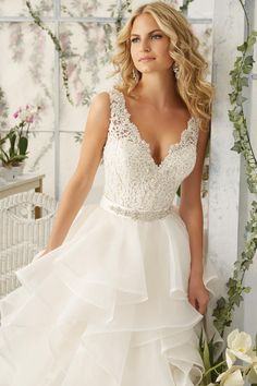 """Morilee Bridal style 2805. Venice Lace Appliqués Sprinkled with Delicate Beading onto the Flounced Organza Skirt - Removable Beaded Satin Belt Included (Also Sold Separately as Style 11222) - Available in Three Lengths: 55"""", 58"""", 61"""""""