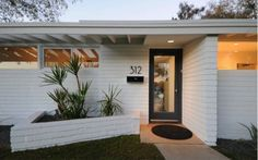 white mid century house with brick - Google Search
