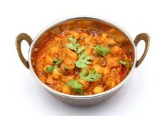Recipe for Chana Masala. This classic North Indian vegetarian dish is a delicious way to boost your intake of protein and fibre-rich chickpeas. Indian Vegetarian Dishes, Vegetarian Recipes Easy, Indian Food Recipes, Ethnic Recipes, No Salt Recipes, Great Recipes, Recipe For Chana Masala, Pickled Shallots, Masala Spice